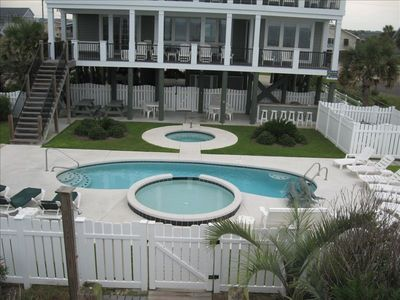Relaxing beachside pool with kiddie pool, dolphin fountain, and hot tub