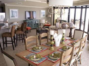 Orange Beach condo rental - Dining and living area, 8 seater table