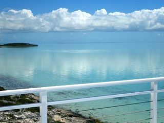 Providenciales - Provo villa photo - A still day looking northeast with North Caicos in the distance.