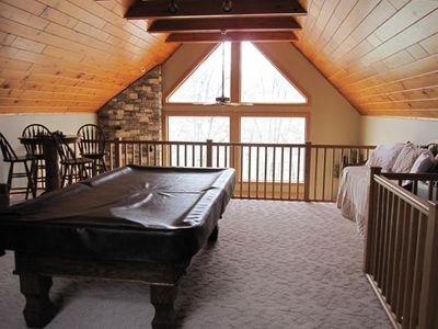 Loft with pool table. Overlooks living room.