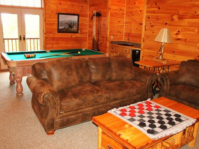 Lower level game room with wet bar, pool table and french doors to hot tub