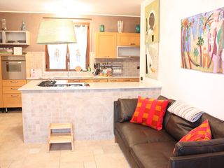 Lezzeno apartment photo - Kitchen area of common room, with L-shaped gas stovetop and ample counter space