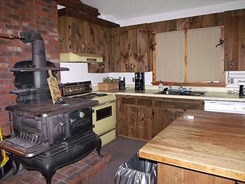 Kitchen, large island for prep with everything you need in the rustic cabinets