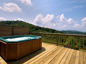 The hot tub looks out over the Smokies and Cherokee National Forest