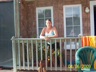 South Padre Island condo photo - That's our daughter on our deck watching her kids in the pool.