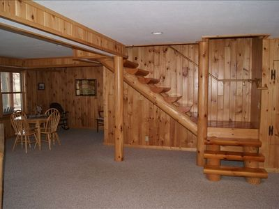 Follow the beautiful, natural pine stairway to the cozy lower level.