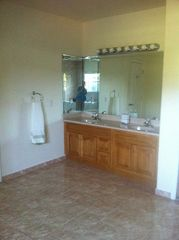 Homestead farmhouse photo - Master Bathroom