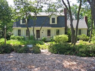 Eastham house photo - The private, wooded, 2/3 acre property