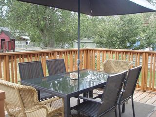 Parksville house photo - New Deck with patio table. You can Watch children or pets while you relax