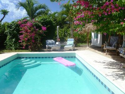 Enjoy your totally private swimming pool- no tan lines! With cushioned loungers in the sun or shade, surrounded by tropical flowers!