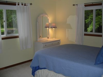 Large bedroom on main floor with queen bed and large double closets.