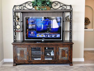 ENTERTAINMENT CENTER AND A 48' TV IN THE LIVING ROOM