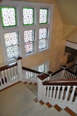 Newport chalet photo - 20 feet of leaded stained glass adorns the stair case.