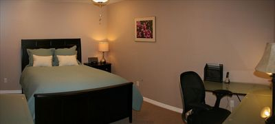 This home has many wonderful rooms! Here is a den with queen bed & office area