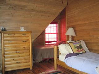 New Buffalo cabin photo - One of two bedrooms upstairs. Each bedroom upstairs has a queen and a twin bed.