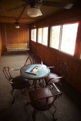 Branson cabin photo - This lovely screened in porch offers a treed hillside view all seasons!