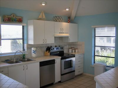 Fully equipped kitchen with a beach view