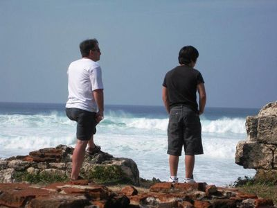 Father and Son enjoying the serene Ocean View