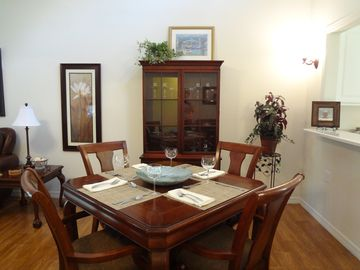 Dining for four. Additional seating in kitchen.