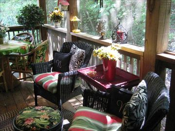 Pick your favorite chair and cozy up with a good book on the screened porch