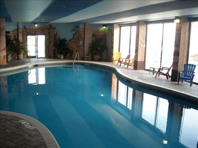 Large indoor pool that is opened up to the outside in the summer