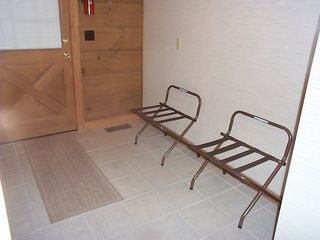 Luggage racks in laundry room - Pigeon Forge cabin vacation rental photo