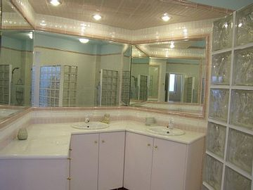 master bathroom, walk in shower for two, Jacuzzi and double sinks.