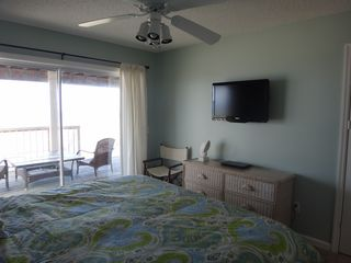 Port St. Joe house photo - Queen room also has a new flat screen mounted on the wall.