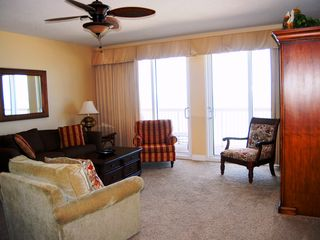 Calypso Resort condo photo - The living area has great comfortable seating for all. Dining for 9.