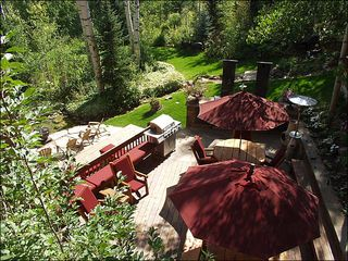 Snowmass Village house photo - Spectacular outdoor living area with large deck, BBQ, stream