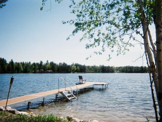 Dock for sunbathing, mooring, swimming and stargazing - Interlochen house vacation rental photo