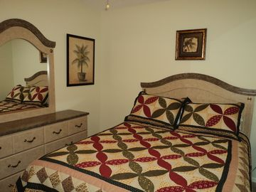 Guest bedroom with queen size bed.