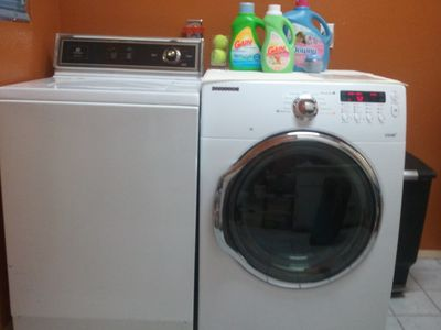 Doing laundry is a cinch with a Maytag washer and new front-load Samsung dryer.