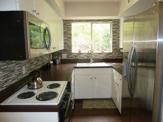Austin house photo - Modern-Vintage Cozy Galley Style Kitchen.