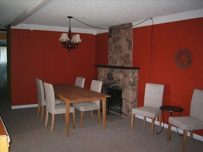 Dining room will fit 8 people by the cozy fireplace