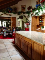 gourmet kitchen with reversible kitchen/poker table - Scottsdale house vacation rental photo