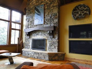 View of Great Room with 2 flat screen TV's and stone fireplace