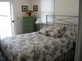Surf City house photo - The tranquil Master Bedroom opens on to the patio.
