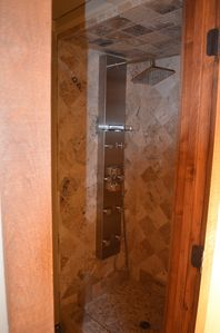 Shower with Rain Head, 8 Body Sprays and Pebble Floor to Sooth & Warm Apre Ski.