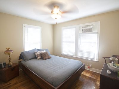 Back bedroom from doorway with ceiling fan and queen size bed.
