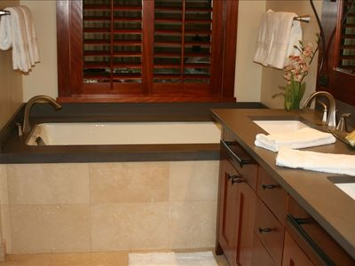 Master bath with large soaking tub, double vanity, shower and floor to wall tile