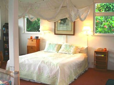 Romantic King Bed with Flowering Plumeria Trees out windows; great airflow breez
