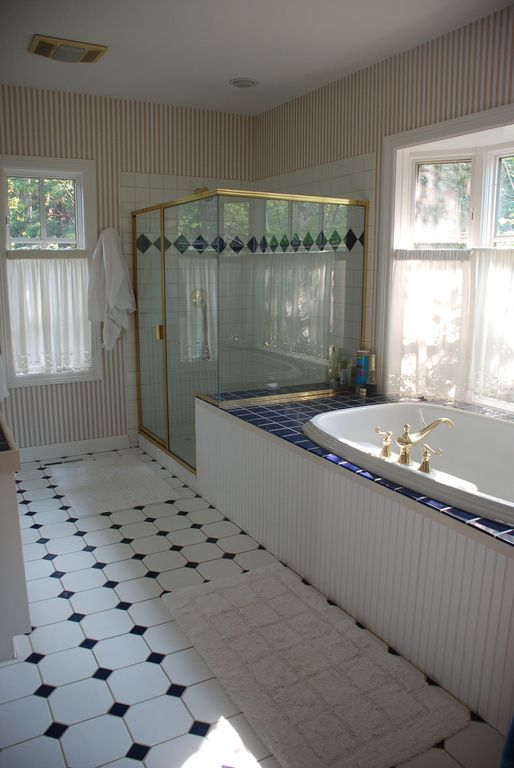master bathroom has shower, bath, two sinks, and sauna