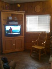 Black Hawk cabin photo - Entertainment Center with Cable TV and DVD/VHS player.