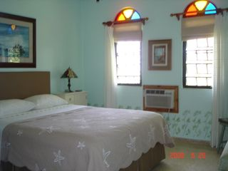 Rincon villa photo - Serene, airy bedroom w queen sz bed, fan, a c