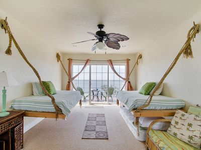 Navarre Beach house rental - Spiral stair leads to room with hanging twin beds, extra twin mattress, balcony.