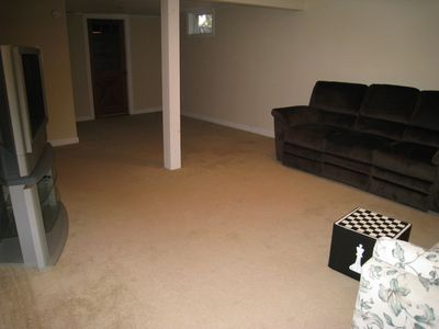 "finished basement with reclining couch and 42"" HD TV"