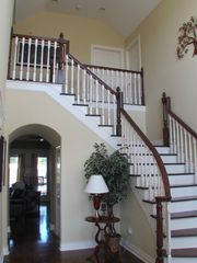 Wide staircase accessing Four bedrooms upstairs and two baths. - Houston house vacation rental photo
