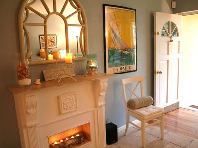 WELCOME ! Front entrance with fireplace. Beautiful soothing ocean colors!