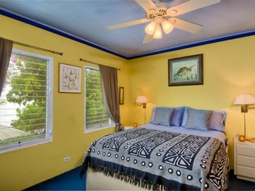 bedroom with a/c & queen size bed & spacious built in wardrobes. Deck outside.